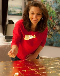 Nancy Reyner applying gold leaf