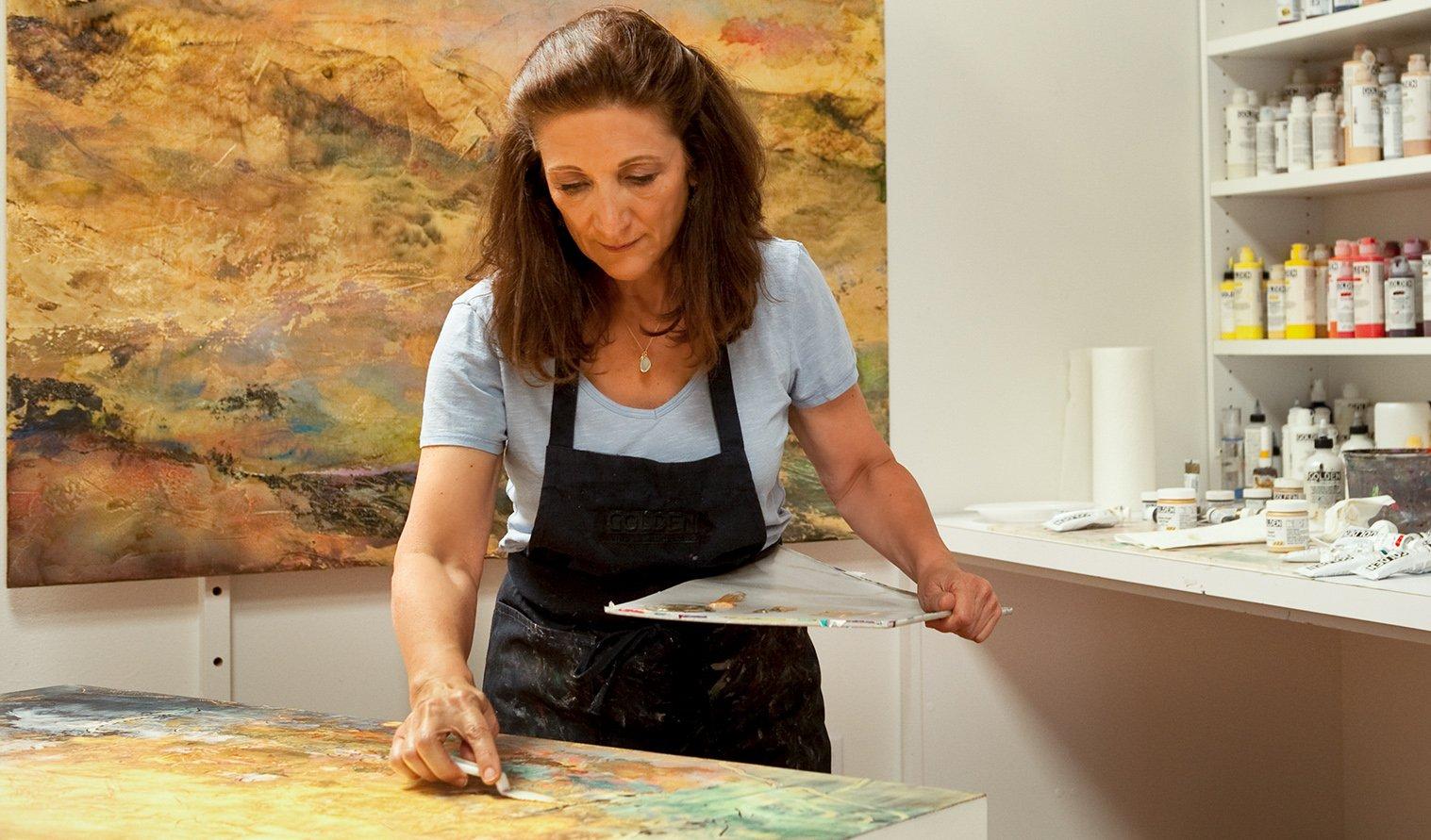 Nancy Reyner painting in her studio